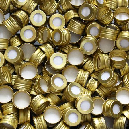 tampa-metal-dourada-furada